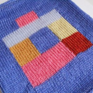 a knitted swatch using intarsia in bright colours
